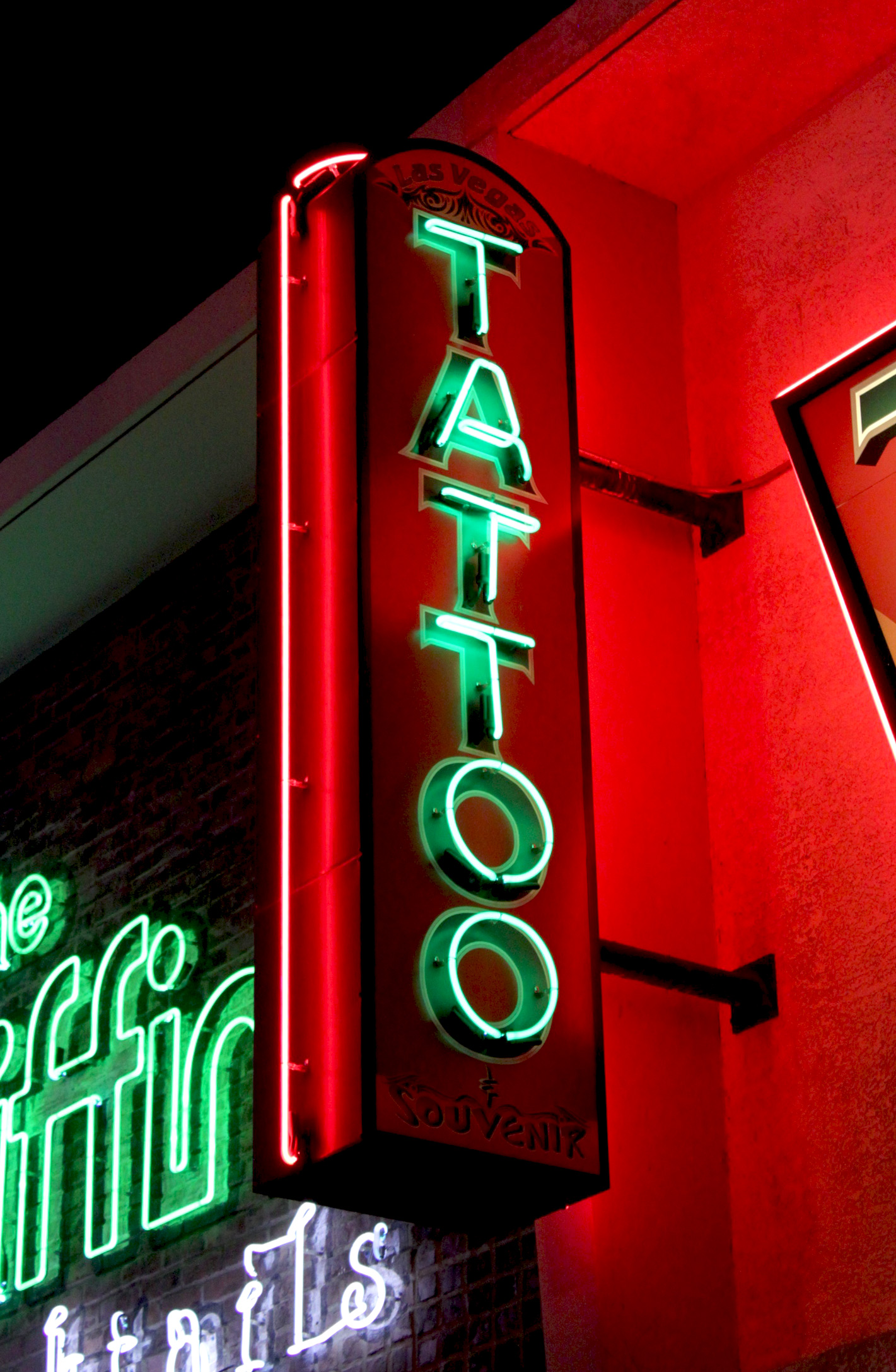 Daily neon las vegas tattoo neon sign at night las for Neon tattoo signs